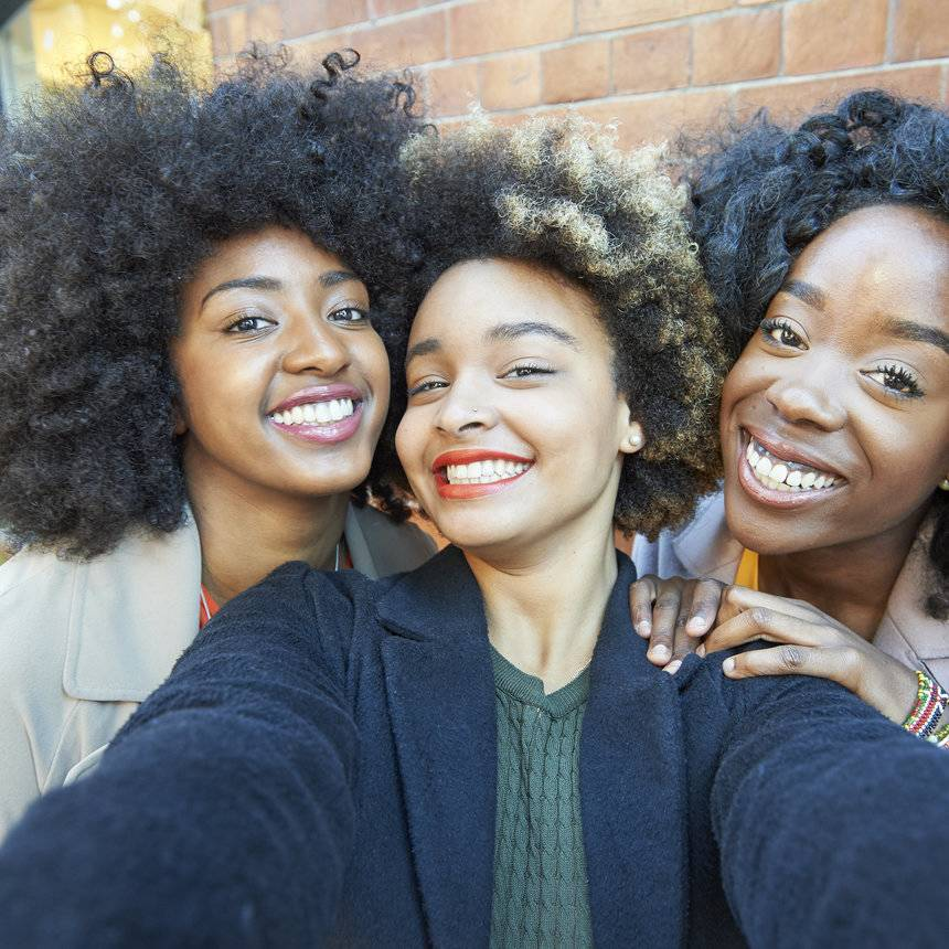 Selfie of three young beautiful Black women that are friends.